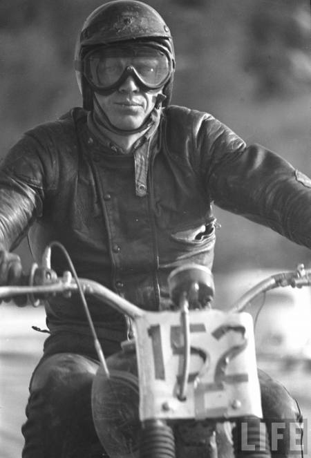 Actor Steve McQueen on motorbike during 500-mi. race across Mojave Desert.