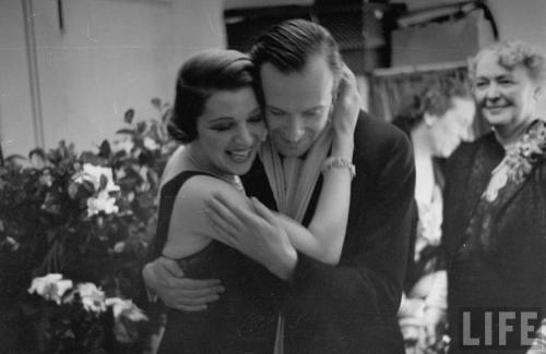 "Actress Ina Claire hugging Cecil Beaton at the opening of ""Once Is Enough""--  circa 1937"