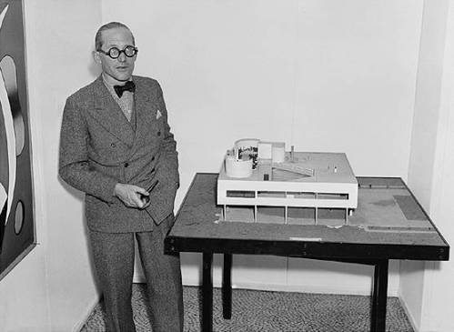 Le Corbusier with an architectural model of his Villa Savoye