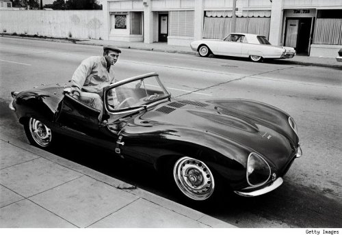 Steve McQueen hopping in his Jaguar XKSS-- 1963.