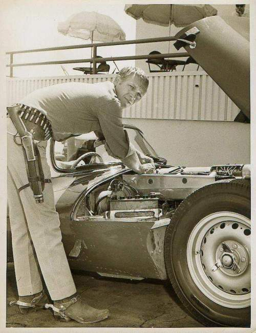 Steve McQueen tinkering between shooting scenes for Wanted dead or Alive.