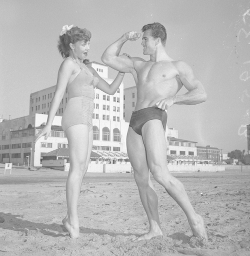 Ed Holovchik [aka Ed Fury], bodybuilder and Mr. Los Angeles contestant with model Jackie Coey-- 1953.