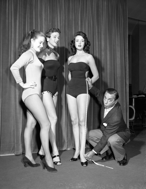 Comedian Eddie Cantor with beauty contestants Lisa Davis, Barbara Drake and Phyllis Applegate, Los Angeles, CA --circa 1954.
